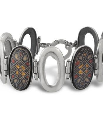 https://studionikolas.com/produkt/damska-srebyrna-grivna-s-keramika-729b/